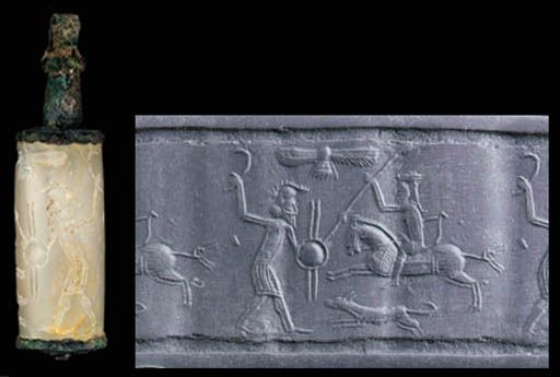 Achaemenid cylinder seal, chalcedony, 5th- 4th century B.C.   With a Persian horseman spearing an infantryman, the horse with a cropped tail and a decorated saddle blanket, the rider wearing folded Persian headgear, tunic and trousers, a bow over his arm which holds the reins,with a dog, perhaps a saluki, running along beside the horse, and a winged solar disk in the sky, with the original bronze mount, 5 cm high. Private collection