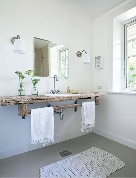 Get creative when introducing texture into your bathroom. Why not add a beautiful piece of wood to your space?: