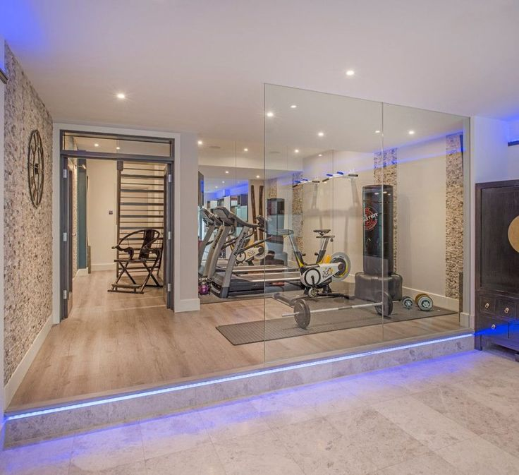 Cool contemporary home gym by London Basement