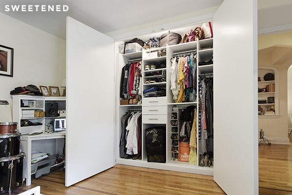Brooklyn bedroom closet with side-by-side doors, double hanging rods, open shelving, and drawer storage.