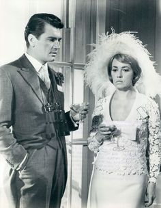 EDMUND PURDOM AND JEANNE MOREAU IN THE YELLOW ROLLS ROYCE