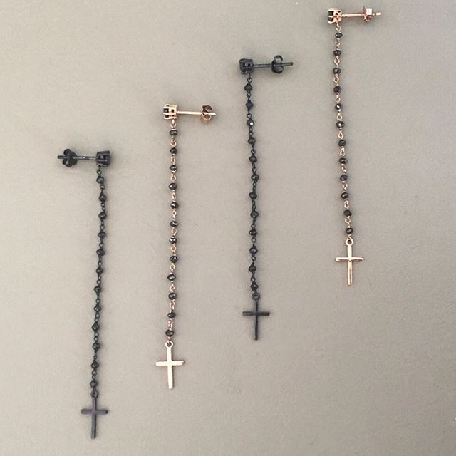 NIVES I Rosary collection Long 18k black gold rosary style earrings with tiny black diamond beads and plain cross end pendant and long 18k light rosé gold rosary style earrings with tiny black diamond beads and plain cross end pendant.