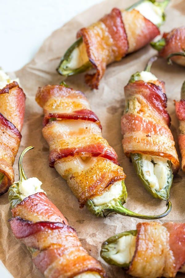 Stuffed with cheesy goodness and wrapped in bacon, these jalapeno poppers are lip smacking, finger-licking delicious either hot or cold!
