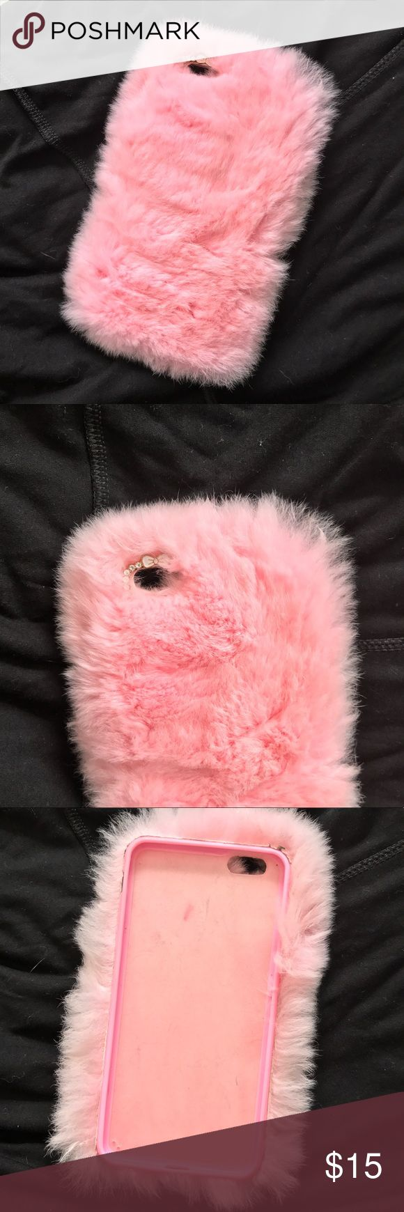 Pink Furry iPhone 6  Case Pink Furry iPhone 6  case. Small rhinestone bow detailing around camera. This phone case is so soft and cute. Only selling because I upgraded my phone Accessories Phone Cases