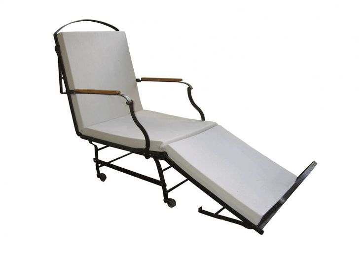 Campaign lounge chair. I love this because it works in with your existing wrought iron chairs, looks the part and looks comfy