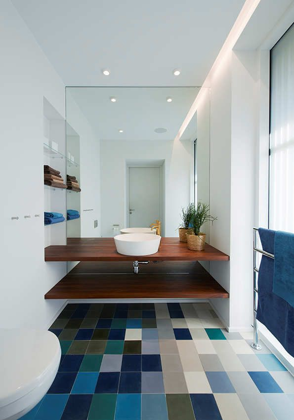 Warm modern bathroom. Love the tile, love the mirror wall. Not sure I ever loved a mirror wall before, but this makes so much sense, especially if you have a really small bathroom.