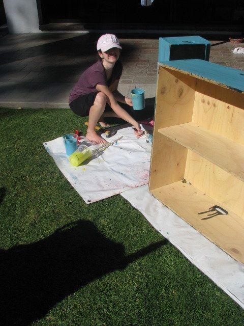 Sam paints old theatre platforms.
