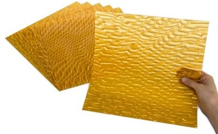 """Gold Serpentine - Made in the USA, translucent, easily cut with scissors, perfect for scoring, folding, embossing and die cutting! Stunningly brilliant optical effects! Add instant pizzazz to craft projects, seasonal accents, party decorations, scrapbooks, greeting cards, jewelry, furniture, frames, gifts, favors, accessories, art and DIY home decor projects. To instantly add """"POP"""" and """"WOW"""" to your projects, just add Rowlux!"""