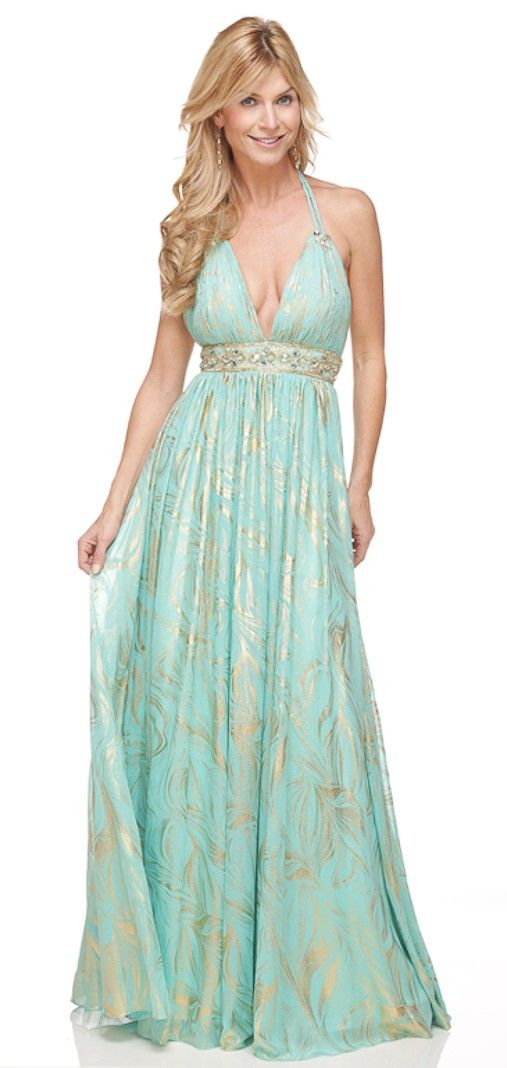 Breathtaking is all I have to say about this simply elegant Shimmer dress. This dress would be perfect for a guest of a beach wedding! This beauty features a shirred bust with a plunging V neckline, a beaded empire waist, and double braided halter strap. The bottom of the dress will be flowing as you dance the night away! Color: Seafoam & Gold Fabric: 100% polyester $60.00
