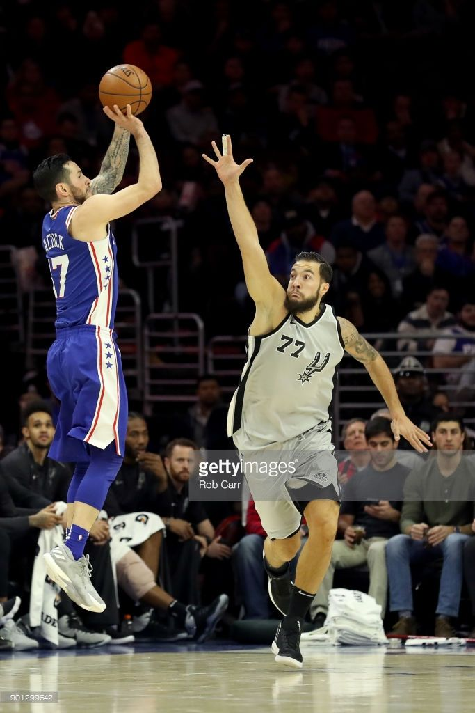 217275cb0d57 JJ Redick of the Philadelphia 76ers puts up a shot over Joffrey ...