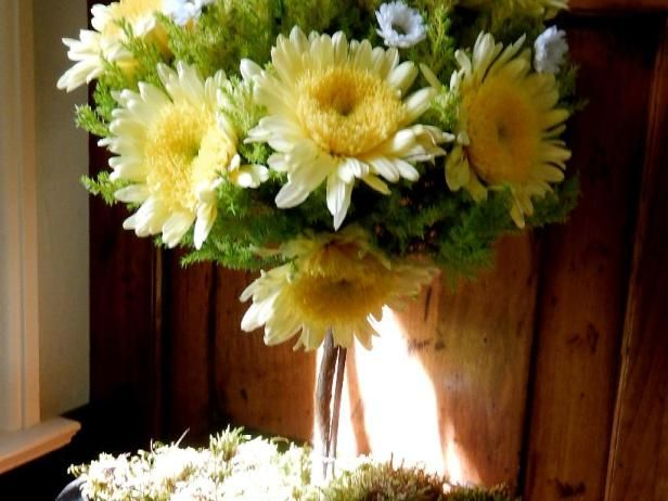 The National Chrysanthemum Society divides the blooms into 13 different classes that range from the exotic to the simple pompon. With so many to choose from, it's fun to try different combinations both planted in the garden and as cut flowers around the house. Here,  bold 'Yellow Cremon' and mini 'Santini' mums work in unison to dress up  a cupressus 'Goldcrest' topiary.