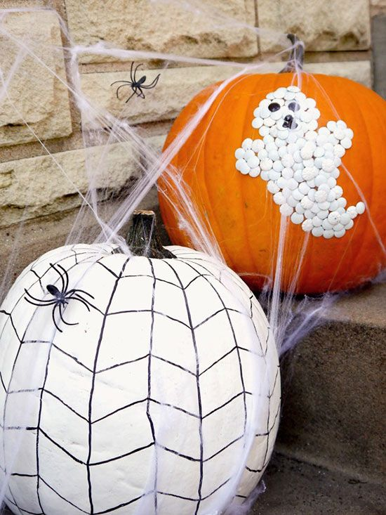 "Create your own ""gourd""-geous no-carve pumpkins by incorporating two traditional office supplies: thumb tacks and a permanent marker. For one, grab a black permanent marker and add a weblike chevron pattern to a white painted pumpkin. For the second, push white thumbtacks into an orange pumpkin in the shape of a ghost. Black thumbtacks provide his eerie eyes and mouth. (image credit: Jamie Dorobek)/"