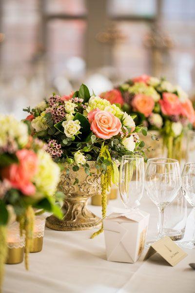 Pink flower arrangements: garden wedding.