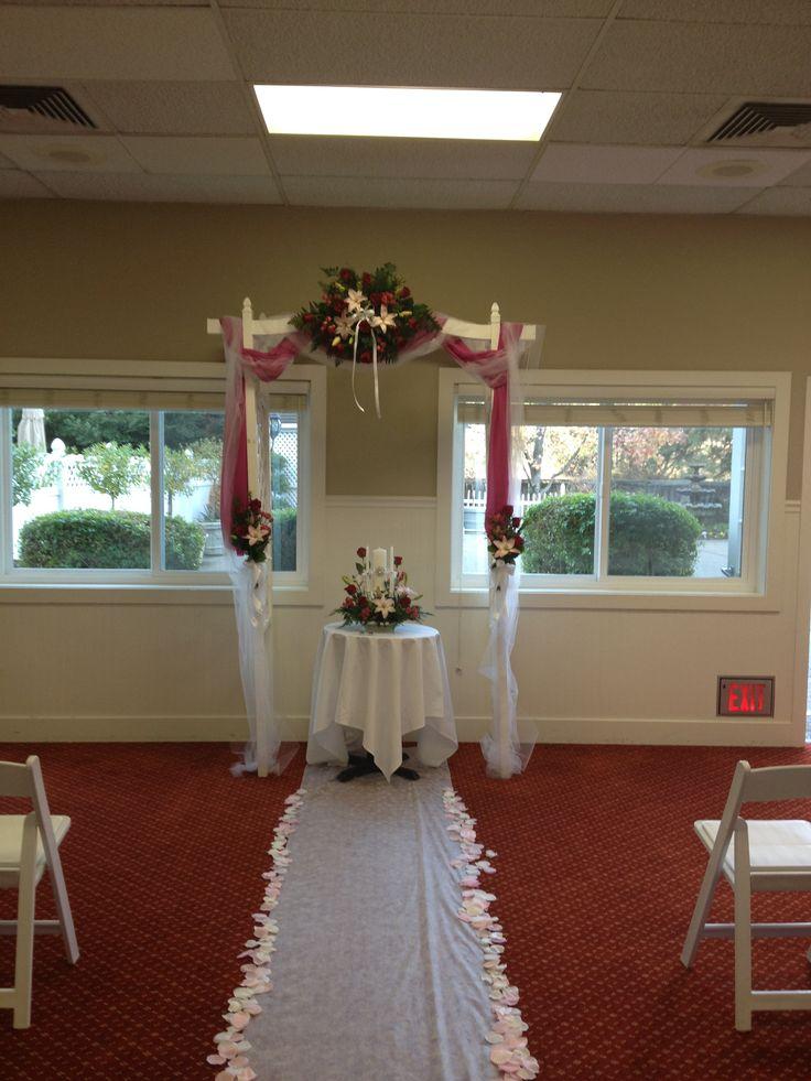 Lake Natoma Inn Wedding. Runner, arch and unity candle flowers. Crystal Rose Florist Folsom CA