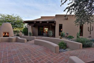 Southwestern Exterior of Home with Fence, outdoor pizza oven, Pathway, exterior tile floors