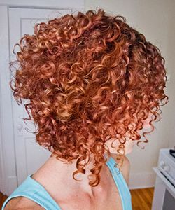 Can you pull off short curly hair? Something to try after I cut it all off.
