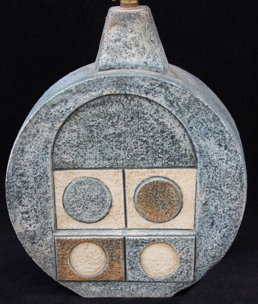 A Troika pottery wheel lamp base, having relief and incised decoration of stylised motifs on a blue ground, signed and with painted initials for Penny Black, height excluding fitting 25.5cm
