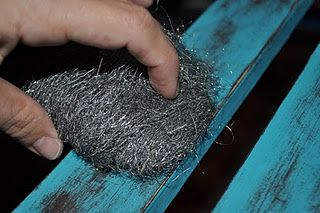 distressing furniture with steel wool, probably a lot easier than using sand paper!