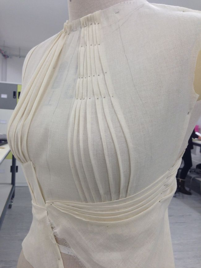 Draping on the stand - bodice design with pleated structure to accentuate the bust waist - fabric manipulation; fashion design; couture techniques