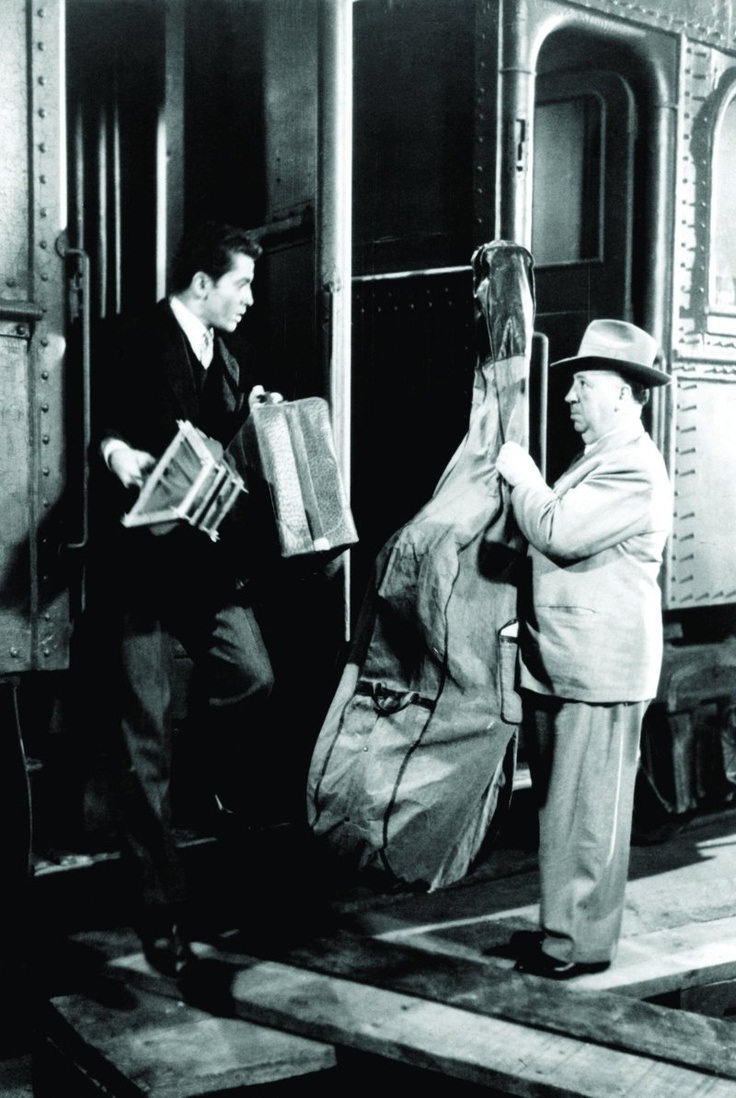 "Alfred Hitchcock's cameo in ""Strangers on a Train"", (1951) with Farley Granger."
