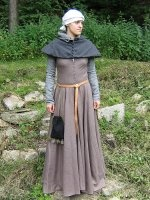A kirtle from the second half of the fifteenth century; laced at the front. Separated bodice is constructed from four parts; the skirt has the shape of a circle. The dress is short-sleeved; the additional sleeves are attached with brass pins.