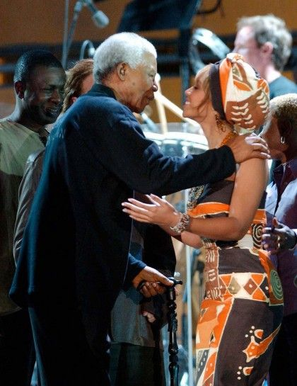 Nelson Mandela's Famous Friends Through the Years Beyonce Knowles gives Nelson Mandela a hug at the 'Give 1 Minute To Aids' Concert at the Greenpoint Stadium in Cape Town in 2003.