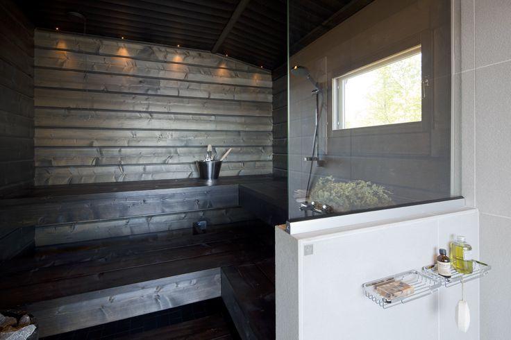 A fresh combination of white and dark brown. Honka log homes.