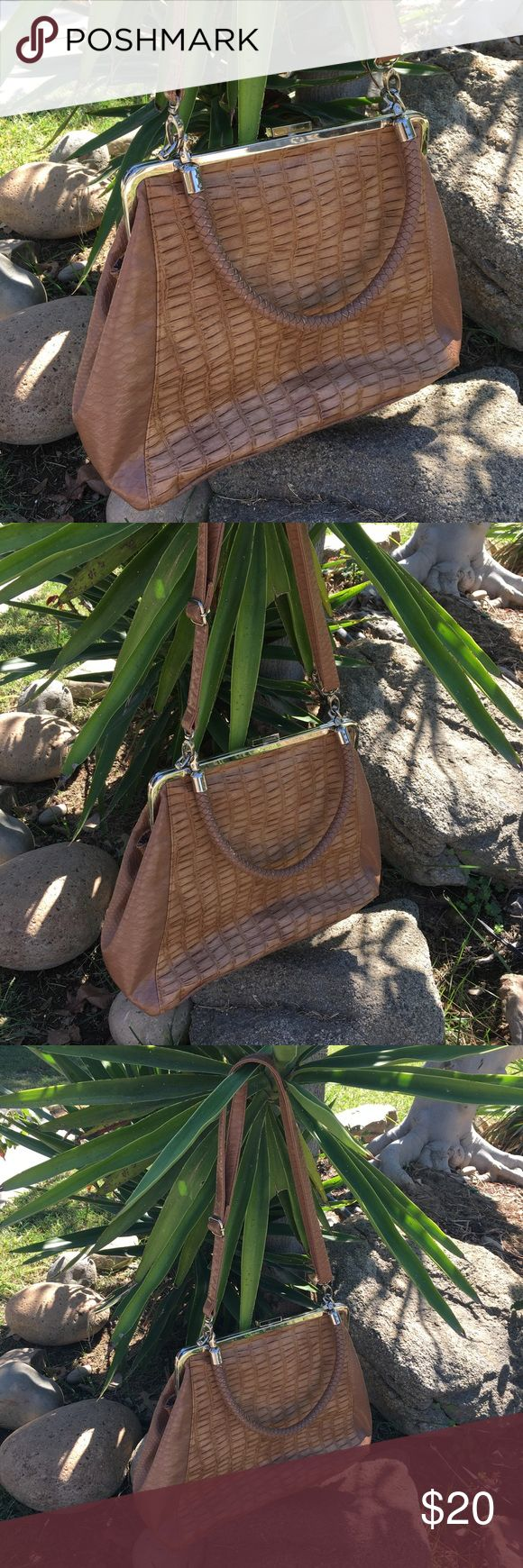 🍃Gorgeous Snake Skin Purse🍃🌸👜🌸🍃 🍃Gorgeous Snake Skin Camel Purse🍃🌸👜🌸🍃 I bought it from a wonderful Posher and I love it but it ended up being too big for me. It's a beautiful color, has Snake Skin look to it, very roomy and clean inside. It has a long adjustable strap as well as forearm strap. It's Vintage clasp closure makes the look!! It won't last long!🌸🍃 Expressions Inc Bags Shoulder Bags