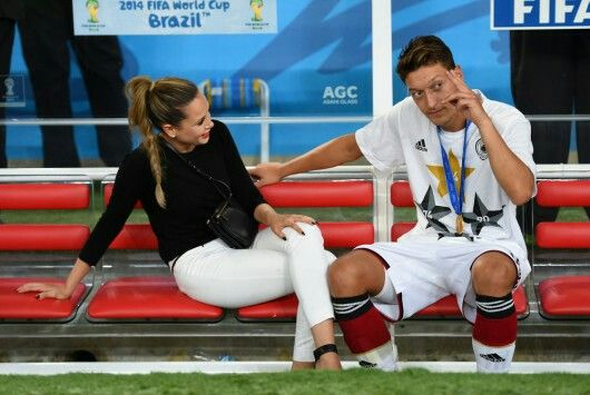 Midfielder Mesut Ozil talking with his girlfriendMandy Capristo: