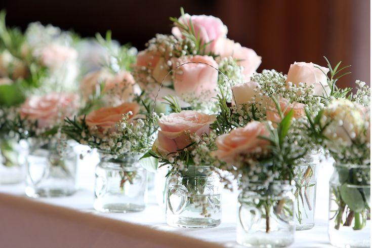 registrar table décor - ceremony table - jam jar flowers - pink roses - gypsophila - rosemary - vintage - wedding flowers - sussex weddings