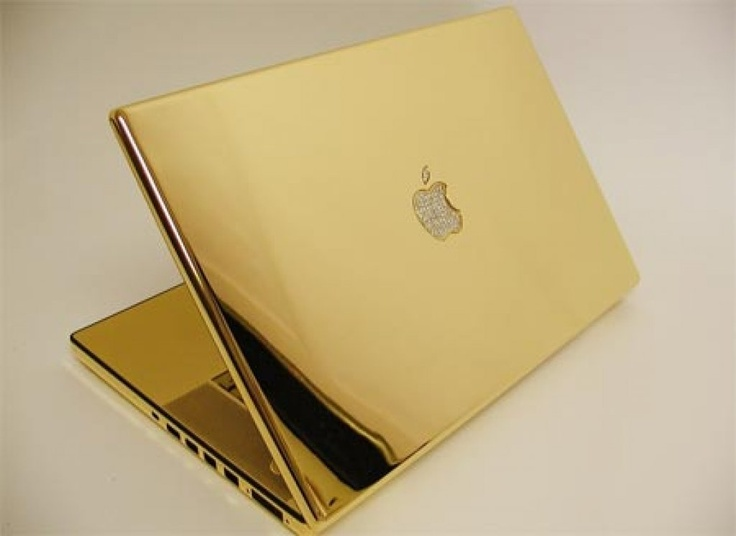 Gold Macbook Pro cover with diamond studded Apple Logo