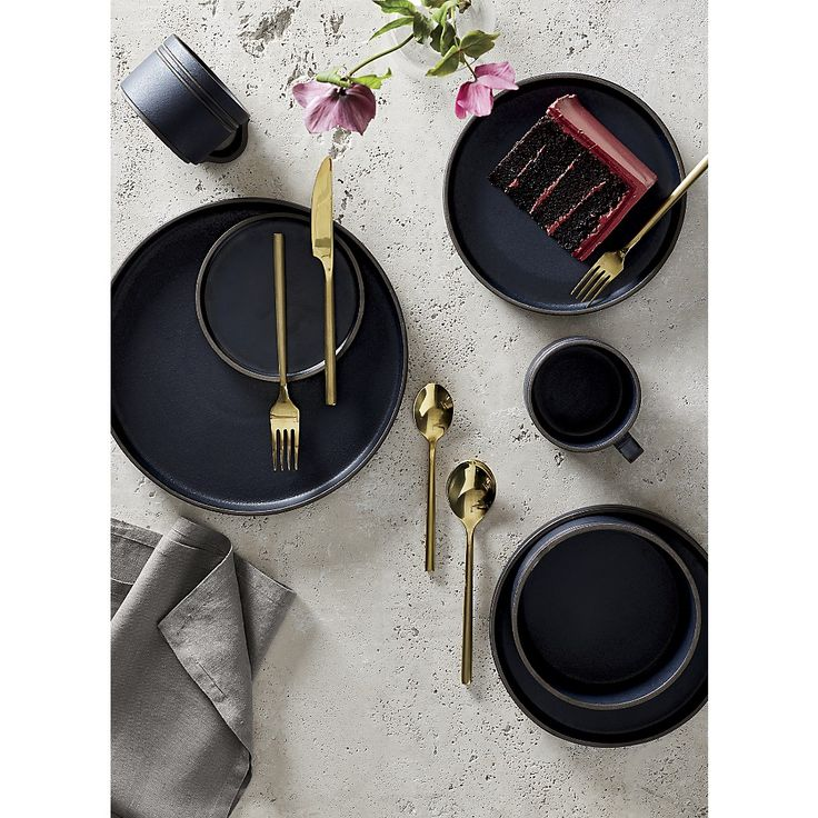 Pitch Dinnerware. Japanese-inspired ceramics set the table with eclectic style. Deep matte black glaze coats dark clay stoneware, revealing itself along rims and handles. Such fine detailing adds texture and a hand-touched feel.