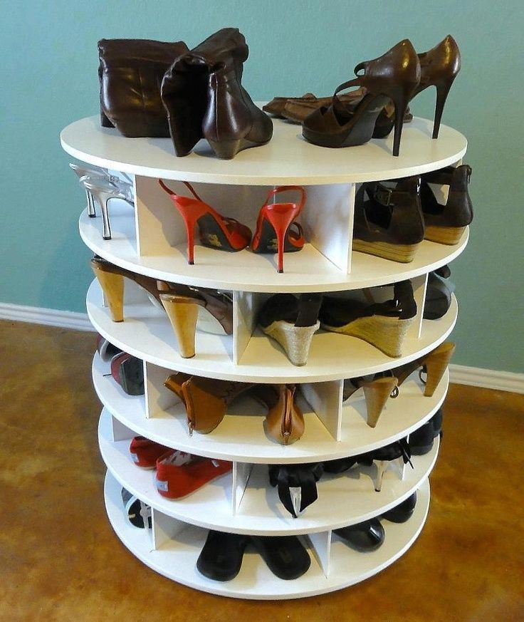Wooden spool repurposed to shoe rack..I'm starting to wish I had a bunch of old wooden spools.