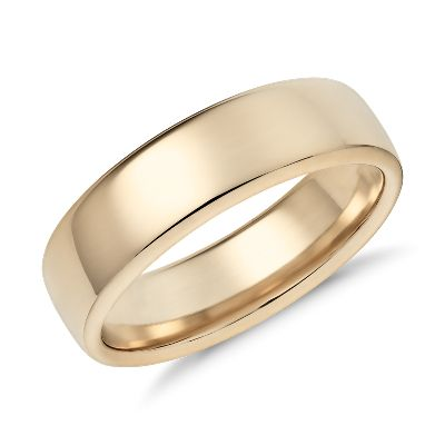 This 14k yellow gold wedding band features a contemporary low dome silhouette with rolled comfort fit edges for comfortable everyday wear.