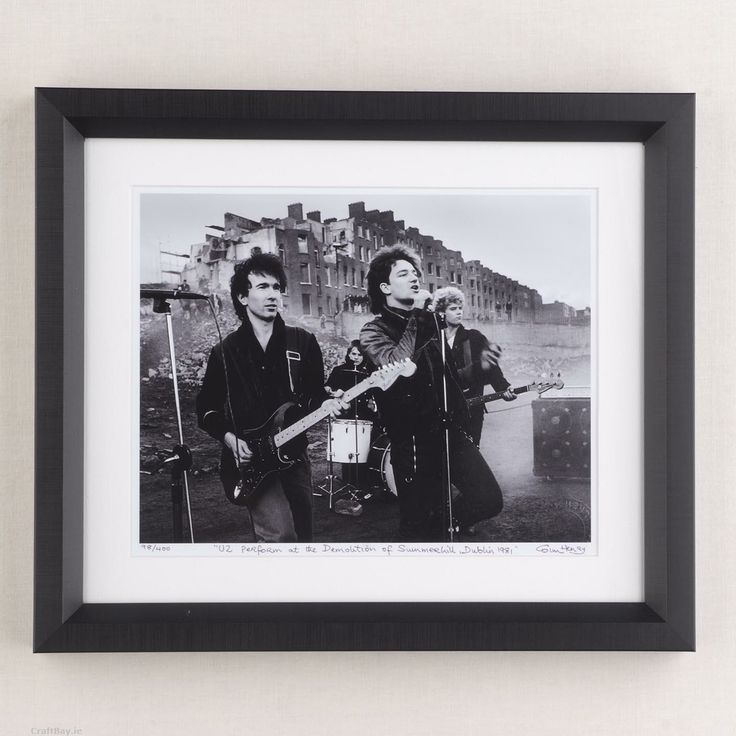 "U2 performing ""Gloria"" at the demolition of Summerhill in Dublin city 1982.  Photo is a limited edition print size 10"" x 12"" signed, numbered, stamped and framed in black box frame by the photographer Colm Henry.  Delivery  - Unless especially specified I will ship your item 1 - 3 days after payment is made.  Shipping to Ireland € 7.50  Shipping to EU €10.00  Shipping to Rest of World €12.50  Payment Method  - PayPal. (If you do ..."
