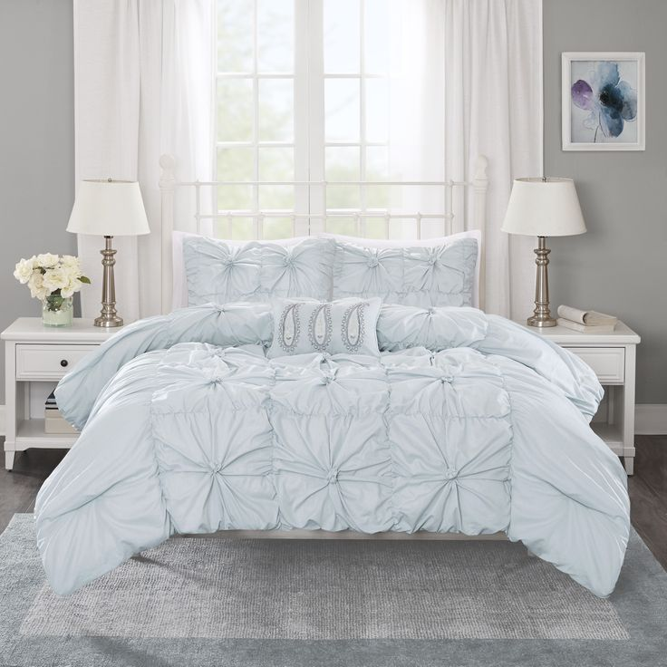 Maxine is a fun and flirty seafoam duvet cover set pieced together with ruching and embroidered details. The center of the duvet cover features a pieced look and the sides are ruched to create a variety of texture and dimension.
