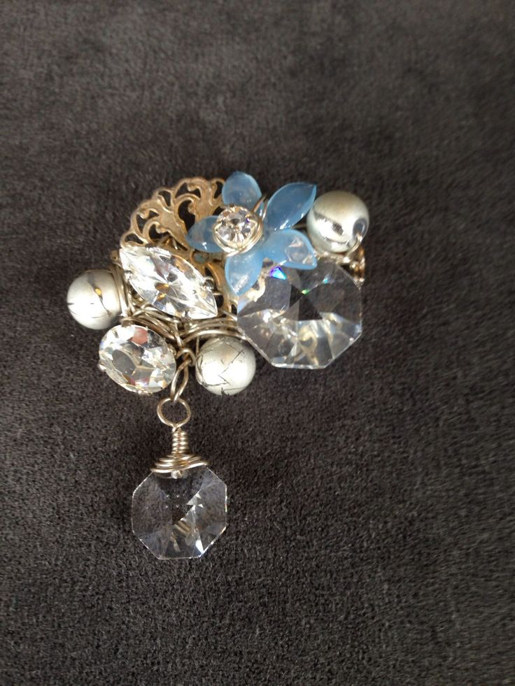 Crystal and rhinestone brooch with blue flower by TrinesTreasures on Etsy