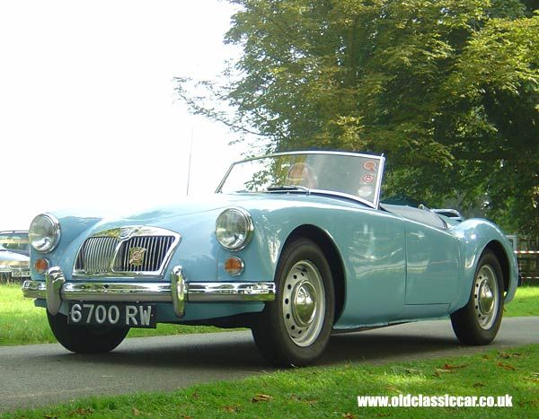 I'm not into cars but this is just ridiculously cool (and classic...and in one of my fave colors), the 1961 MG roadster.