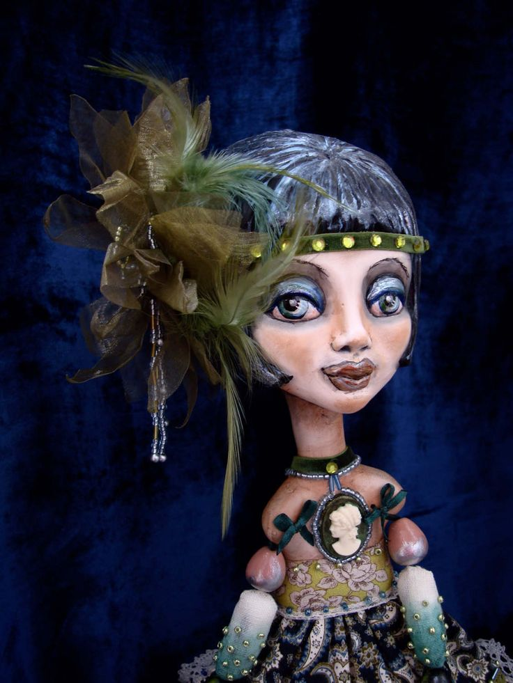 A personal favourite from my Etsy shop https://www.etsy.com/listing/504234068/flapper-doll-ooak-art-deco-interior