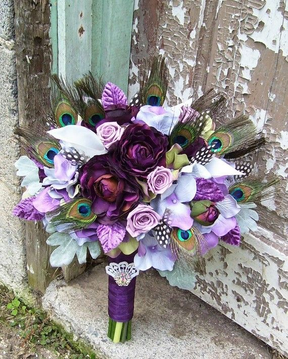 Wedding bouquet with peacock & guinea feather accents.