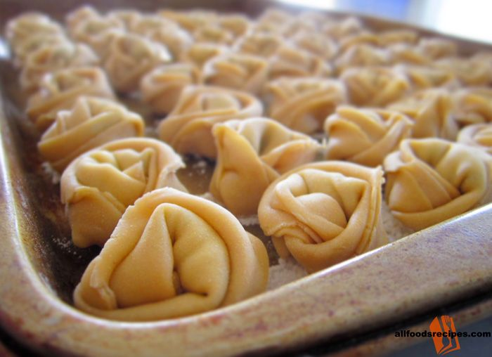 Cheese Tortellini – It is an authentic homemade tortellini prepare with three kinds of cheese and herbs which can used for other preparation.#cheese #tortellini    RECIPE : http://www.allfoodsrecipes.com/recipe/cheese-tortellini/