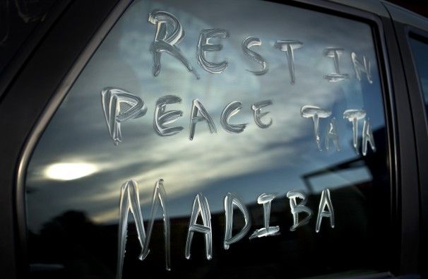 """Ben Curtis/Associated Press -  A message using Nelson Mandela's clan name """"Madiba"""" and a term of affection """"Tata"""" meaning """"father"""", is scrawled on the window of a car parked in the street outside Mandela's old house in Soweto, Johannesburg, South Africa Friday, Dec. 6, 2013. South Africans of all races often referred to Nelson Mandela as simply """"Madiba"""" or """"Tata"""", terms of endearment."""
