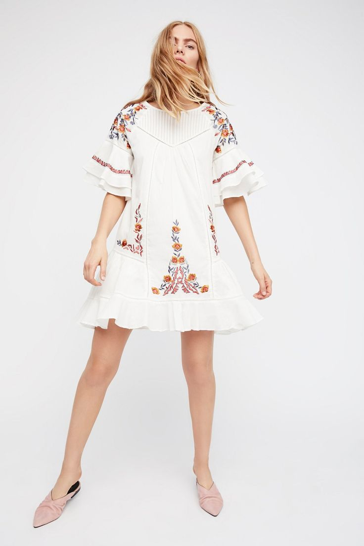 Pavlo Dress | Breezy cotton dress featuring beautiful floral embroidery and a femme flared hem and sleeves.    * Shapeless fit   * Sheer fabrication