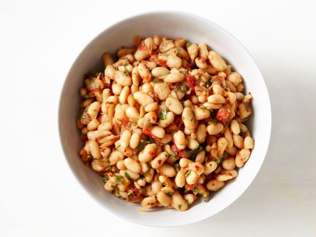 Tuscan White Beans : Dress up canned cannellini beans with tomatoes, rosemary and Parmesan for an easy-to-make weeknight side dish.