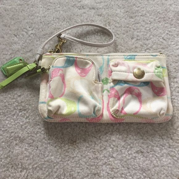 Coach wristlet Pastel coach wristlet! Cream with pink, neon yellow, and blue C's. Several pockets in the inside. Small zippered pocket on front. It has seen better days needs to be cleaned. Price reflects condition. 8 inches by 4.5 inches. Strap can be unhooked and clipped on zipper or clipped on side ring. Coach Bags Clutches & Wristlets