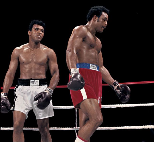 "Muhammad Ali stares down George Foreman during their 1974 ""Rumble in the Jungle"" in Zaire. Ali won by knocking out Foreman in the eighth round. (Neil Leifer/SI)  GALLERY: Rare Muhammad Ali Photos 