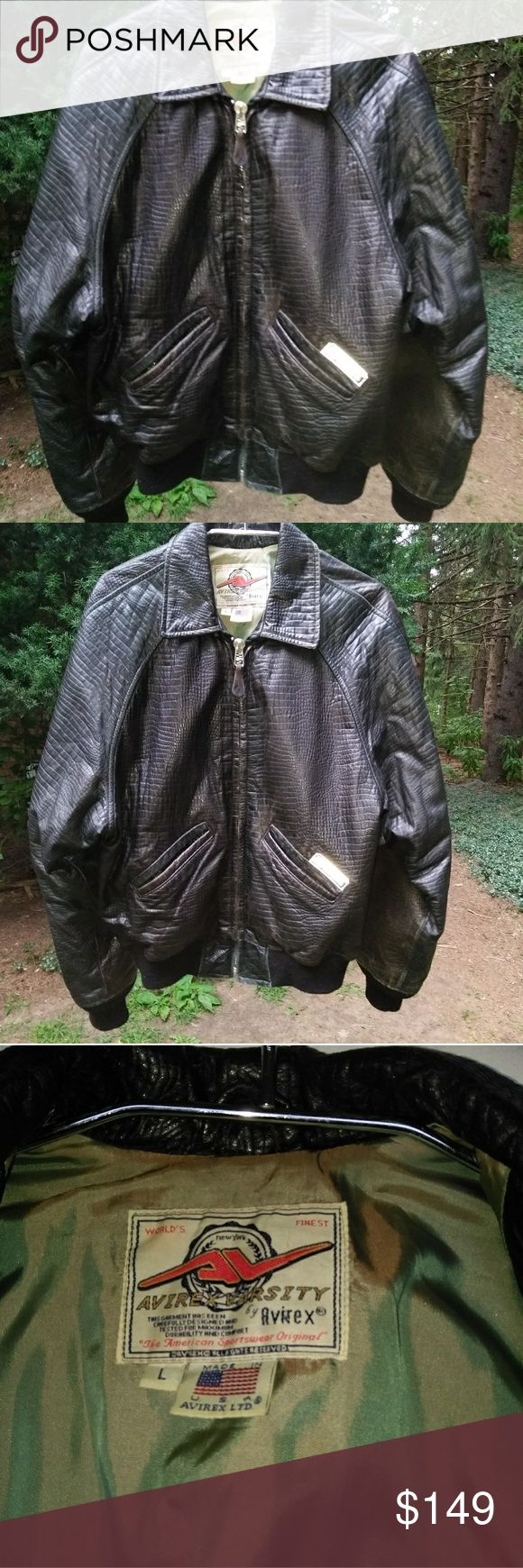 """Vintage AVIREX textured black leather jacket L Gorgeous jacket.  It is in excellent condition.  Has ribbed knit cuffs and waist.  Zipper works great.  Pretty shiny green lining. Two front slant pockets. It is marked a size large. The leather has a reptile or snake texture.  Measurements are ...46"""" chest,  40"""" waist across bottom of the leather,  21"""" underneath the sleeve to the end of sleeve, 35 1/2"""" from the center of the collar to the end of the sleeves, 25"""" length from the top of the…"""