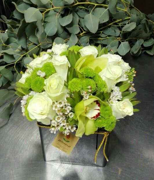 Flower arrangment ordered om our website. White and green flowers... we love it!