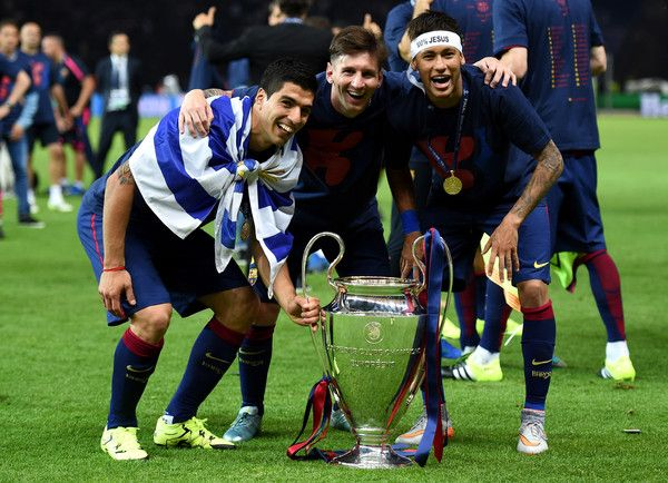 (L-R) Luis Suarez, Lionel Messi and Neymar of Barcelona celebrate with the trophy after the UEFA Champions League Final between Juventus and FC Barcelona at Olympiastadion on June 6, 2015 in Berlin, Germany.