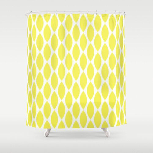 Shower Curtain in a yellow and white ikat petal pattern adds a touch of glamour to your bathroom.    - Shower Curtain: 71 x 74 inches (standard